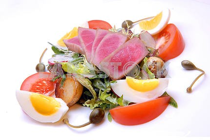 Salad from a tuna with vegetables and egg