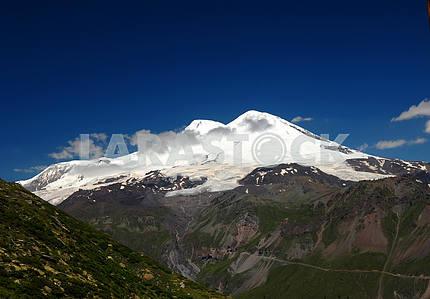 Peak Elbrus in the summer in solar weather