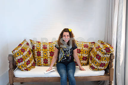 Zanzibar beautiful girl sitting on the couch