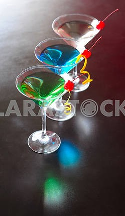 Classical martini with berries of a cherry
