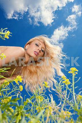 Portrait of smiling girl in blue sky