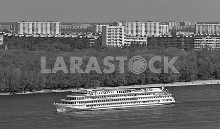 Modern ship on the Dnieper River in Kiev, on the background of the residential area Berezniaky