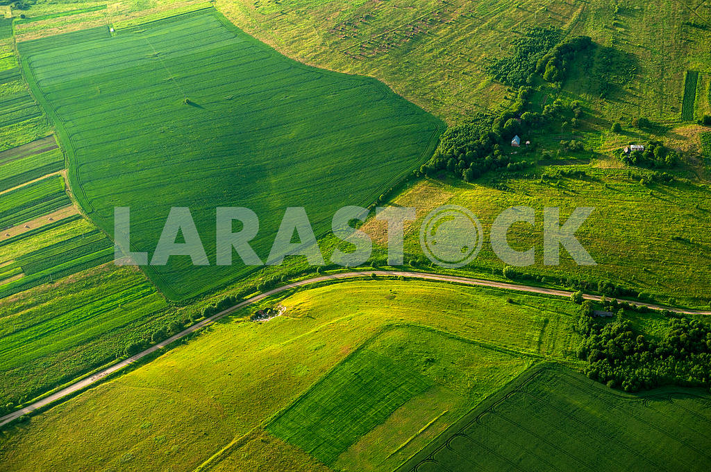 Aerial view on green and yellow parts of fields and countryside — Image 34598