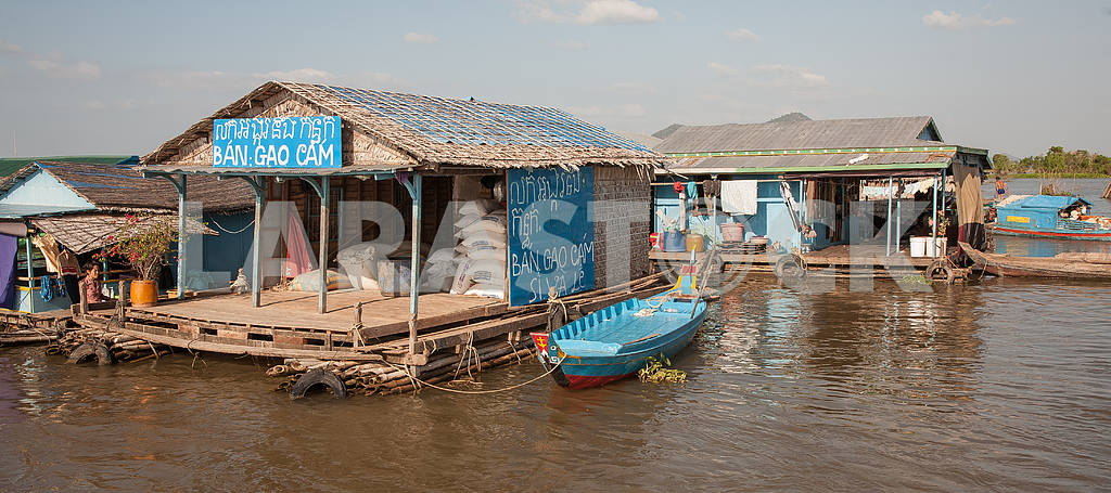 Warehouse with building materials on the water works on ozereTonlesap in Cambodia.