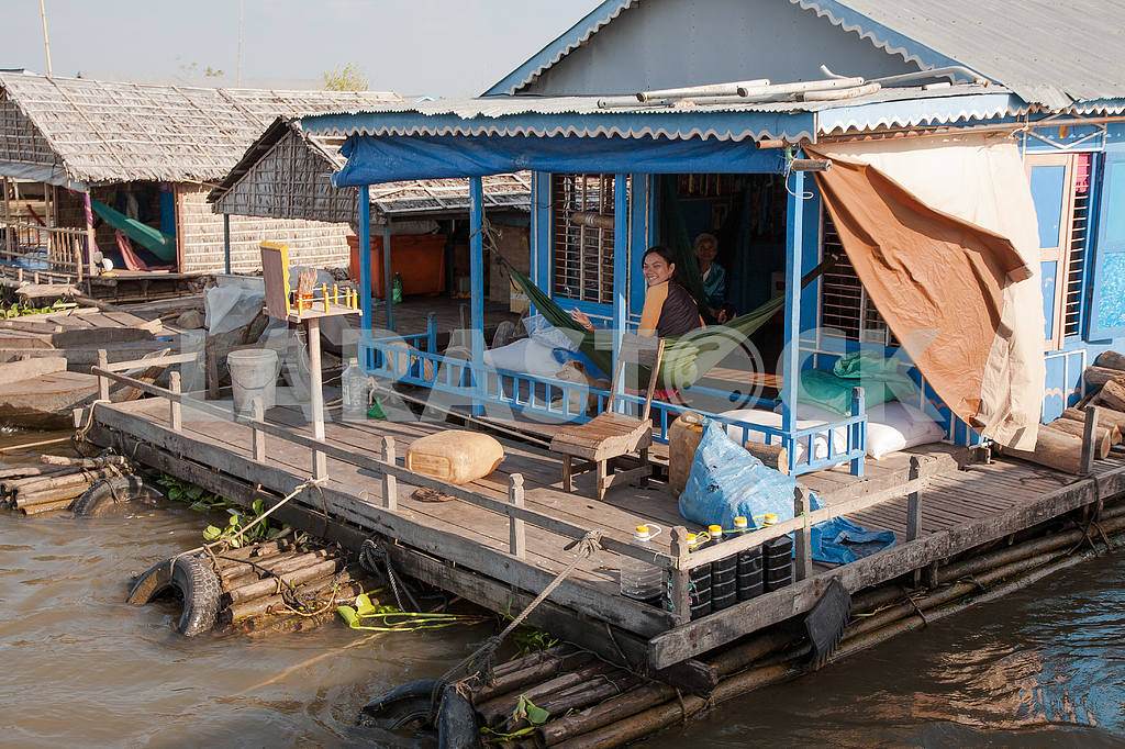 On the terrace of the house of the village on the water Tonle Sap Lake in Cambodia in a hammock relaxing family — Image 3464