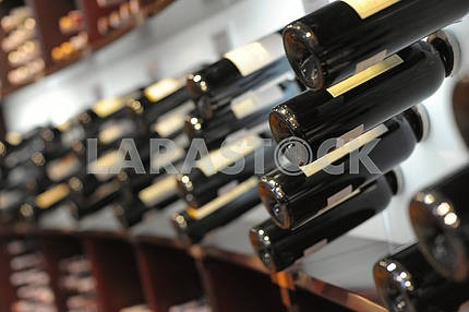 Wine bottles in shop of spirits