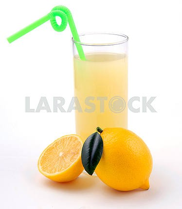 Lemon juice in a glass and an lemo