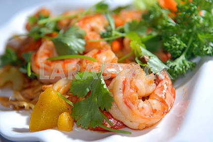 The big tiger shrimps with vegetables and nuts