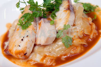Rizotto with a fried pike perch in sauce