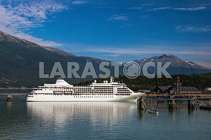 Cruise ship on the background of mountains