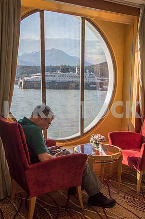 Tourist resting in the window cruise ship