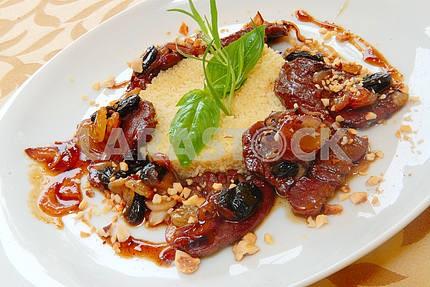 Porridge kus-kus with beef and raisin