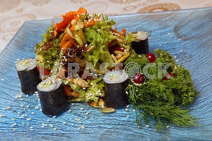 Spring salad from fresh vegetables with rice beaters