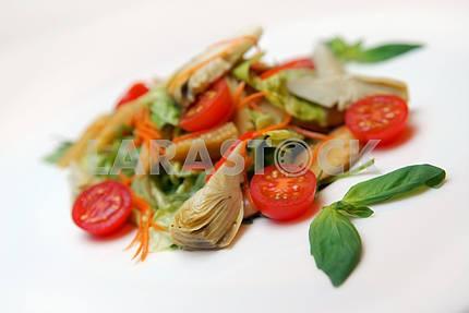 Salad from artichokes, ears of corn