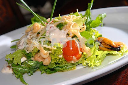 Salad from vegetables and seafood