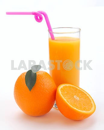 Orange juice in a glass and an orange