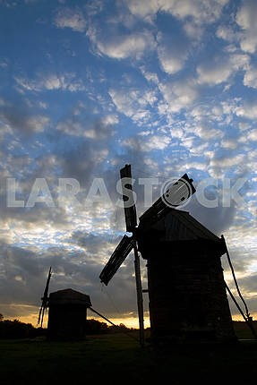 Windmills against the sunset sky