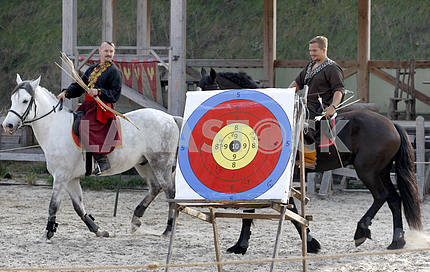 Archers on horseback near a target for archery