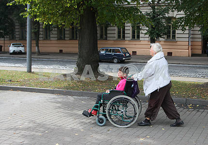 Woman and boy in a wheelchair