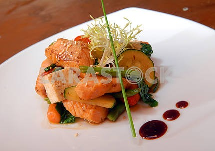 Salad of grilled vegetables with slices of salmon