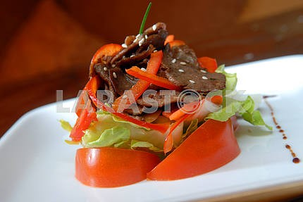 Salad from fresh vegetables and beef meat