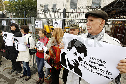 Activists hold placards in front of Russian Embassy