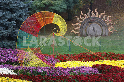 Fragment of the exposition of roses with the sun in the background