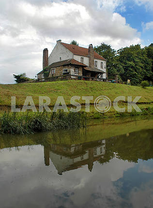 Village houses with reflection in a pond