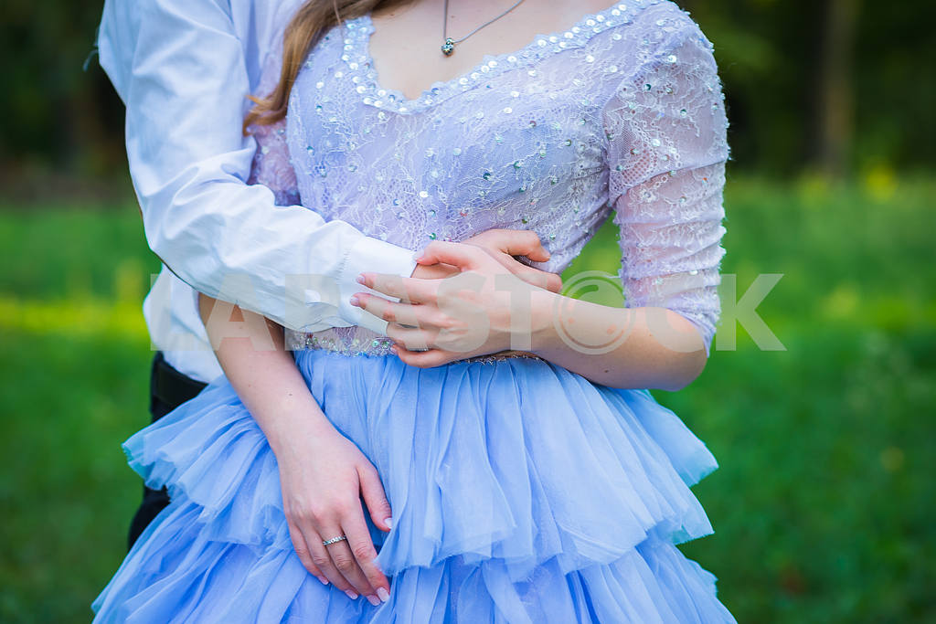 A love story couple, in love, together in the forrest park, girl in a beautiful violet dress, sunny evening, summer, thematic wedding shooting, frill dress — Image 39066