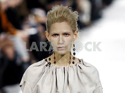 A model  demonstrates outfit by Ukrainian designer Elena BURENINA