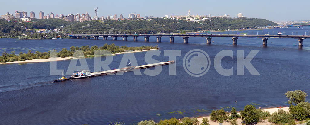 Panorama of Kiev and the river Dnepr with the barge