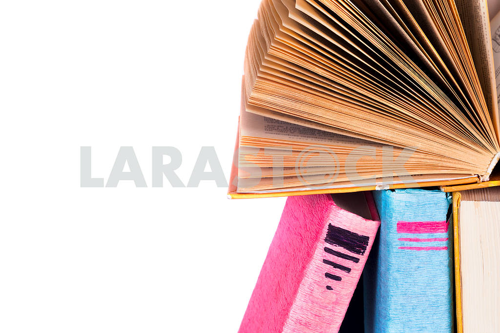 Open book, stack of colorful hardback books on light table. Back to school. Copy space for text — Image 41844