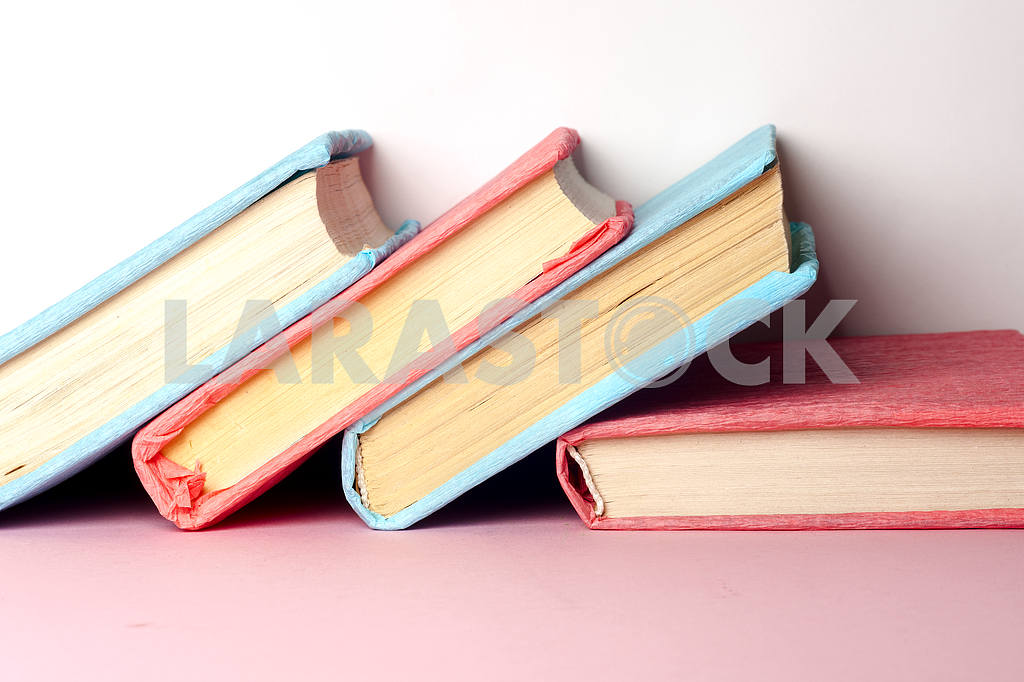 Top view of bright colorful hardback books in a circle. — Image 41992