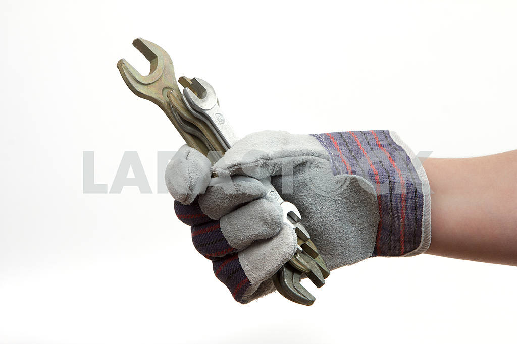 Gloved hand holding a wrenches — Image 4378