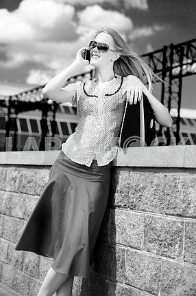 Black & White portrait smiling sexy blonde girl talking on phone
