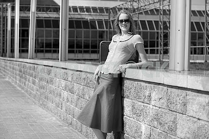Smiling sexy blonde girl wearing skirt