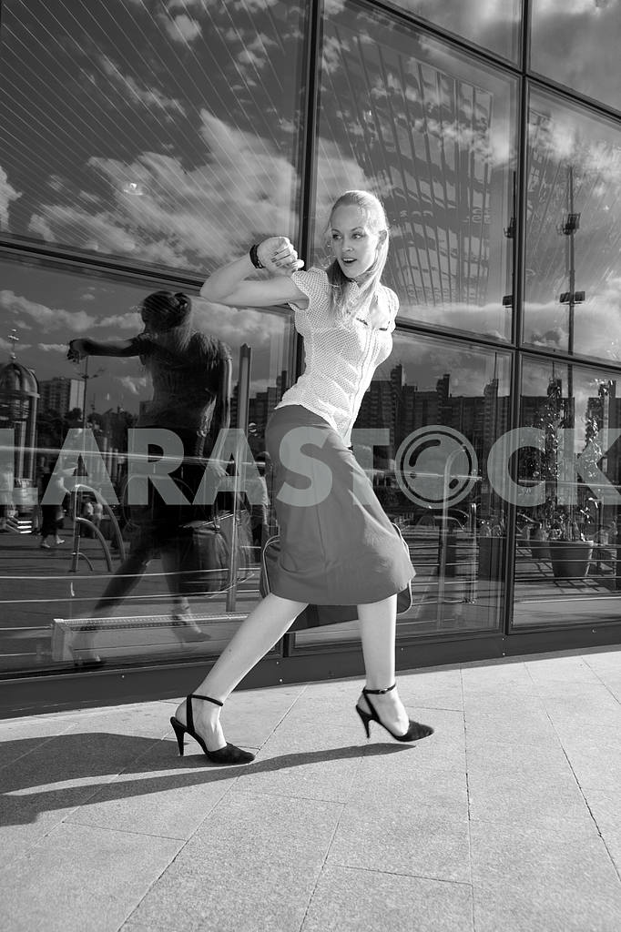 Black and White Young woman, blond, runs against the backdrop of — Image 4484
