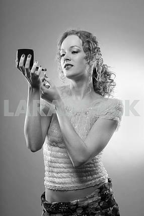 Pretty woman applying make-up with powder