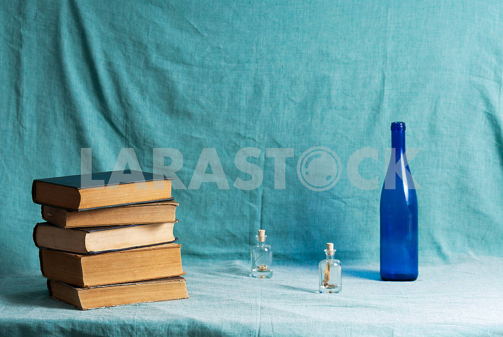 Stack of hardback books on blue cloth. Back to school. Copy space — Image 45325