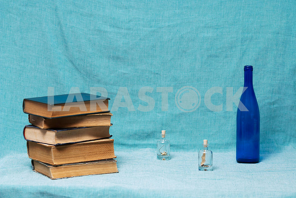 Stack of hardback books on blue cloth. Back to school. Copy space — Image 45326
