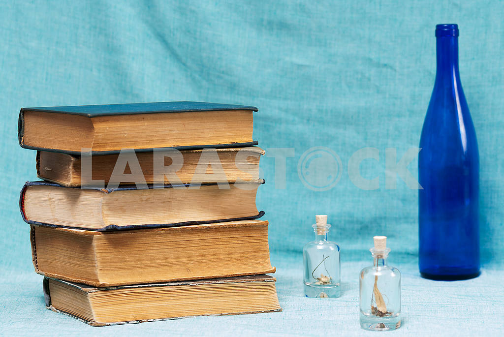 Stack of hardback books on blue cloth. Back to school. Copy space — Image 45329