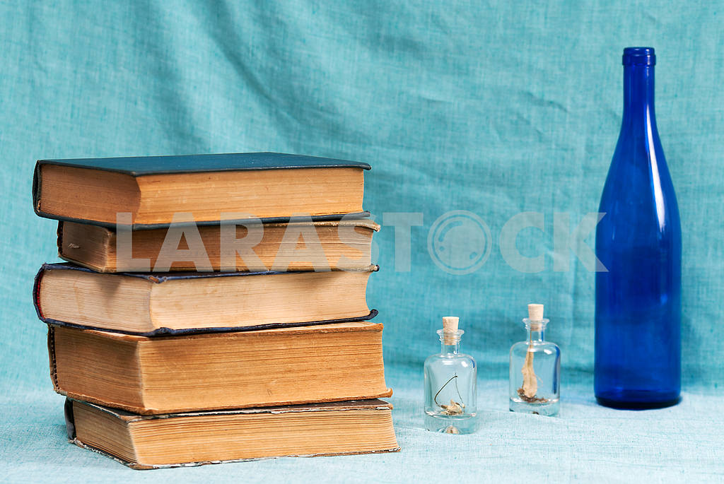 Stack of hardback books on blue cloth. Back to school. Copy space — Image 45331