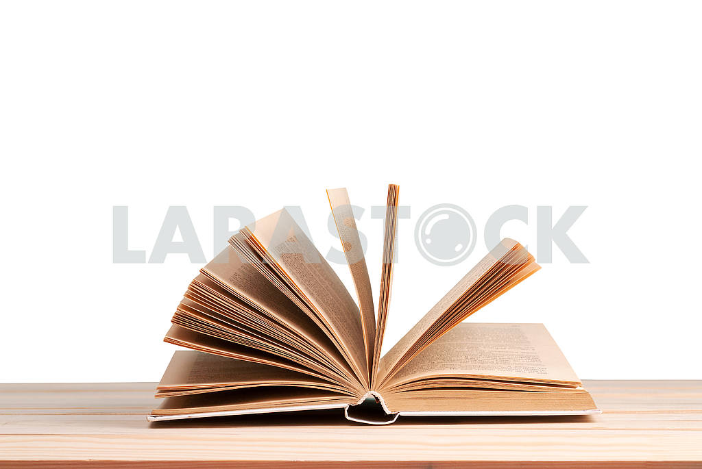 Stack of hardback books on blue cloth. Back to school. Copy space — Image 45333