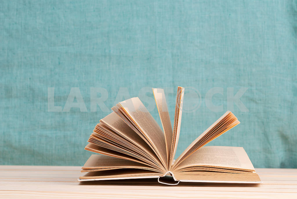 Stack of hardback books on blue cloth. Back to school. Copy space — Image 45334