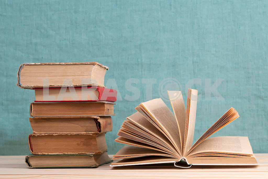 Stack of hardback books on blue cloth. Back to school. Copy space — Image 45335