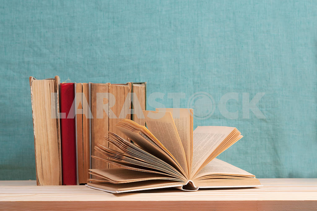 Stack of hardback books on blue cloth. Back to school. Copy space — Image 45341