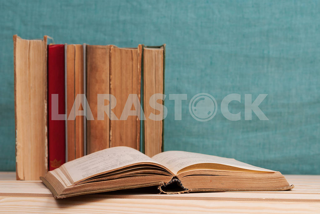 Stack of hardback books on blue cloth. Back to school. Copy space — Image 45343