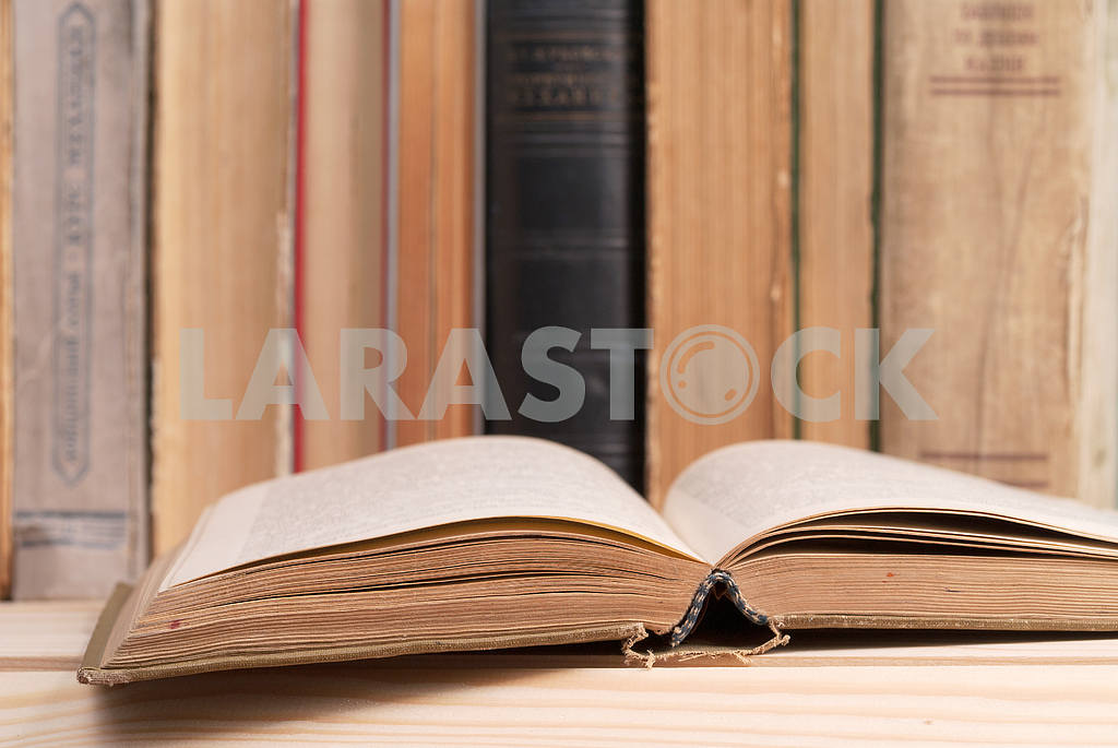 Stack of hardback books on blue cloth. Back to school. Copy space — Image 45345