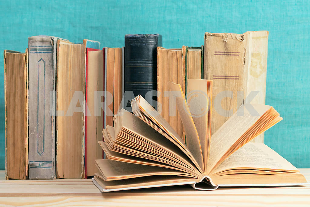 Stack of hardback books on blue cloth. Back to school. Copy space — Image 45351