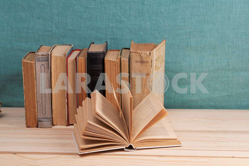 Stack of hardback books on blue cloth. Back to school. Copy space — Image 45352